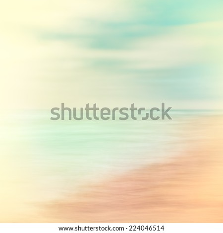 A seascape abstract made with panning motion combined with long exposure.  Image displays soft contrast with split-toned colors. - stock photo
