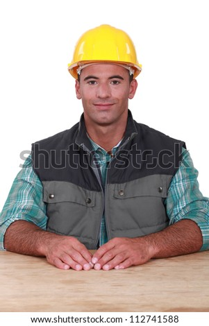 A seated handyman. - stock photo