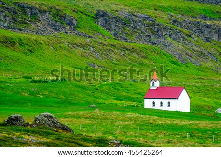 A secluded church near the Vatnsfjordur fjord, in the west fjords region, Iceland - stock photo