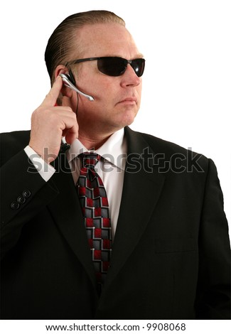 "a Secret Service Agent talks into his microphone  ""isolated on white"" - stock photo"