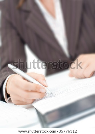 a secretaryl writing a letter on the paper