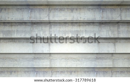 A section of empty concrete steps used for stadium seating - stock photo