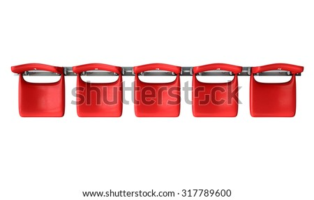 A section of numbered stadium seating with red chairs set in a row on an isolated white studio background - stock photo