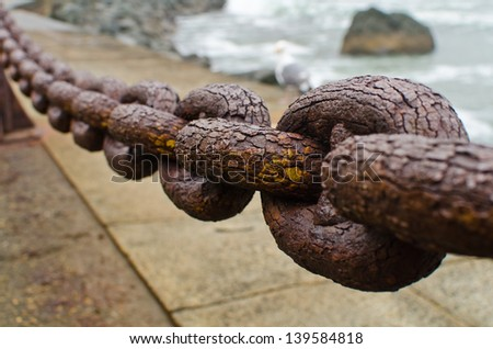 A section of rusty chain - stock photo