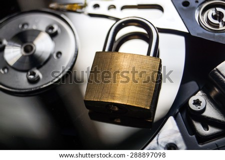 A security lock on computer hard disk / Computer data encryption security - stock photo