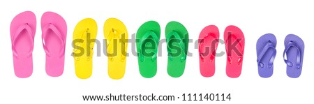 A selection and assortment of rubber flip flops in multiple colors. - stock photo