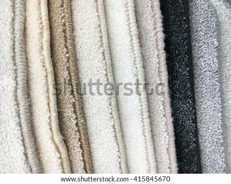 A selection of carpet samples in a homeware store - stock photo