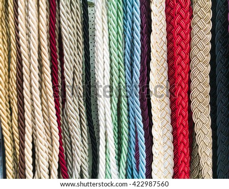 A selection of colorful curtain cords as a background