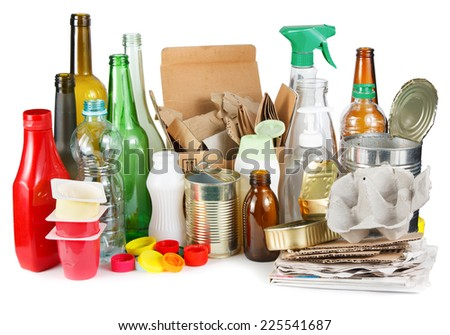 A selection of garbage for recycling. Segregated metal, plastic, paper and glass on white background