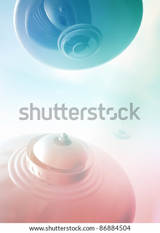 A selection of retro styled UFO's in flight on a colorful background. - stock photo