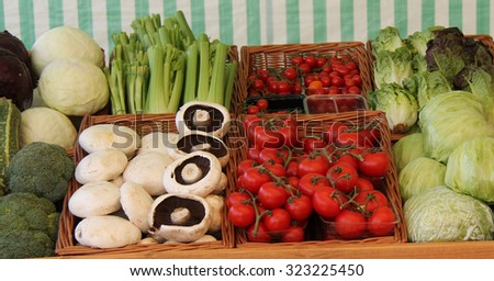 A Selection of Salad Produce for Sale on a Market Stall. - stock photo