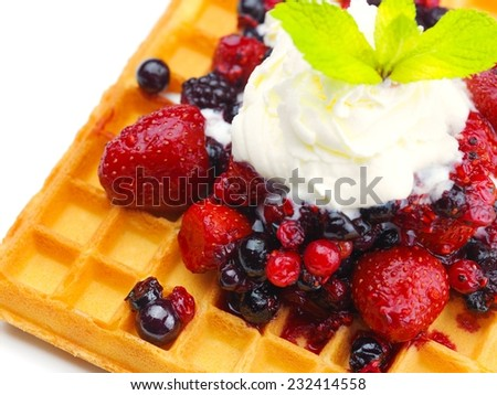 a selection of three italian gelato ice-cream scoops topped with nuts, chocolate, fruit served on crispy waffels - stock photo