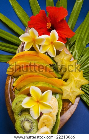A selection of tropical fruits from Hawaii, including kiwi,papaya,banana, mango,and starfruit - stock photo