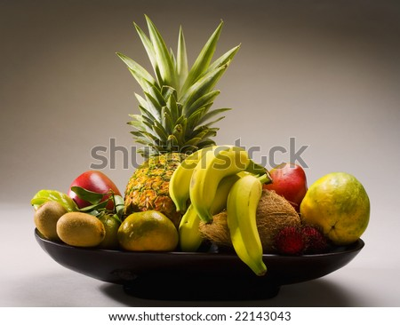 A selection of tropical fruits from Hawaii, including pineapple,kiwi,papaya,banana, and starfruit, - stock photo