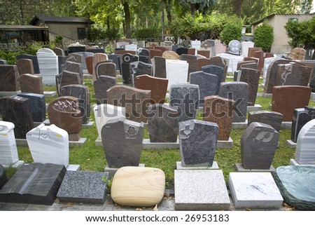 a selection of unused tombstones in a monumental masons yard.