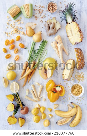 A selection of various yellow foods fruits veg raw organic fresh produce from farmers market - stock photo