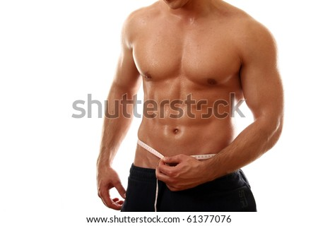 a semi-nude bodybuilder with a measuring tape around his waist - stock photo