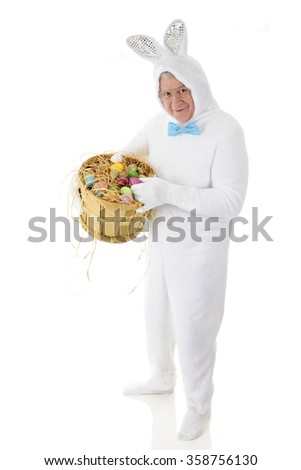 A senior adult man in a white bunny costume happily showing off his bushel basket full of colored eggs.  On a white background. - stock photo