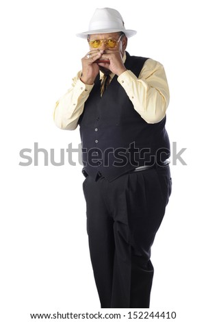 A senior adult man playing his harmonica.  On a white background. - stock photo