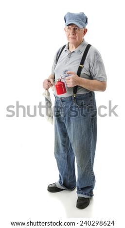 A senior adult train engineer with an oil can and cloth in his hands, waiting for the train.  On a white background. - stock photo