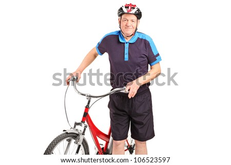 A senior bicyclist posing next to a bicycle isolated on white background