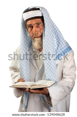 A senior cleric is portrayed with a book in his hands. - stock photo