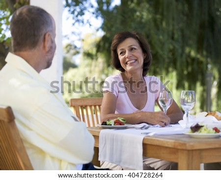A senior couple at a restaurant - stock photo