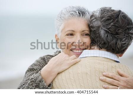 A senior couple embracing - stock photo
