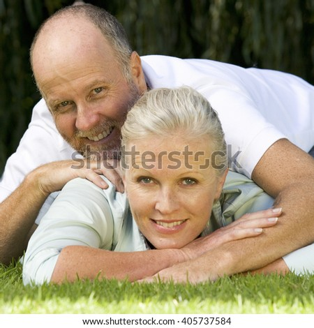 A senior couple in a garden