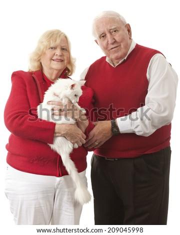 A senior couple with their white cat.  On a white background. - stock photo