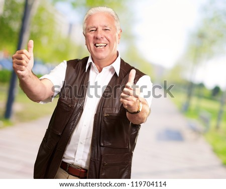 A Senior Man Showing Thumbs Up, Outdoor - stock photo