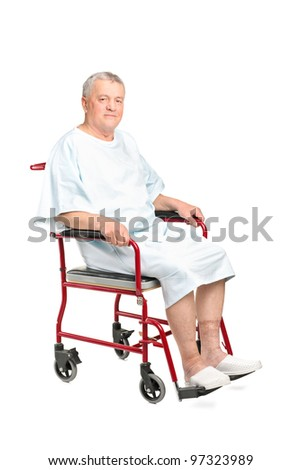 A senior patient seated in a wheelchair posing isolated on white background