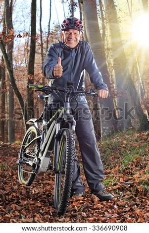 A Senior with e-bike and thumb up - stock photo