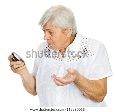 A senior woman stares stunned at something she sees on her smart-phone.  isolated on white background - stock photo