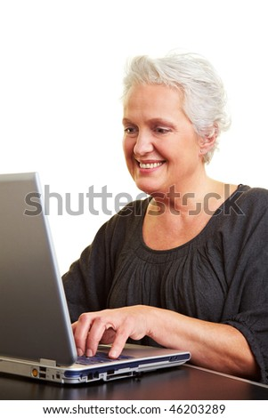 A senior woman working on a laptop