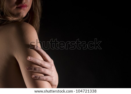 A sensual portrait from back on balck background