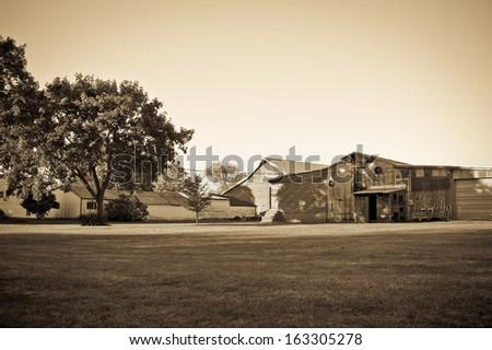 A sepia toned rural farm scene along a roadside in Millstone New Jersey. - stock photo