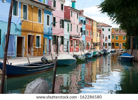 A series of beautiful colored houses on the river channel. Island Burano (Venice, Italy) - stock photo