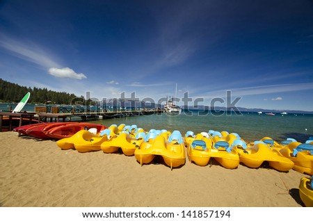 A series of boat at lake tahoe beach - stock photo