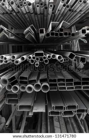 A series of different sizes metal pipes on shelf Metal pipe stack on shelf - stock photo