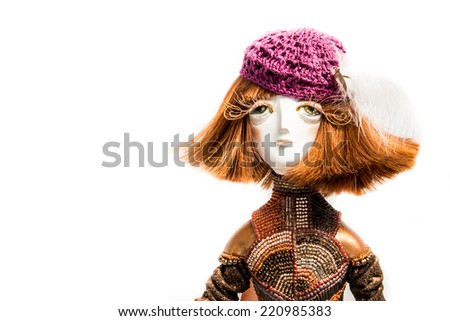 a series of dolls �Seasons'. Autumn. Handmade doll on white background for calendar design and beauty industry
