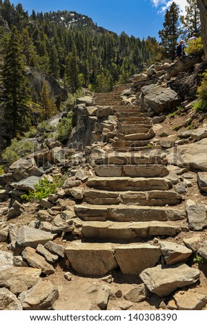 A series of granite stone steps form the hiking path above Lake Tahoe - stock photo