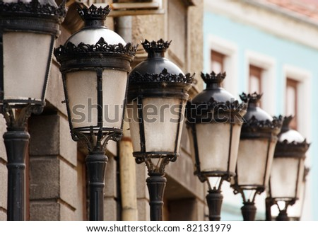 A series of vintage street lamps - stock photo
