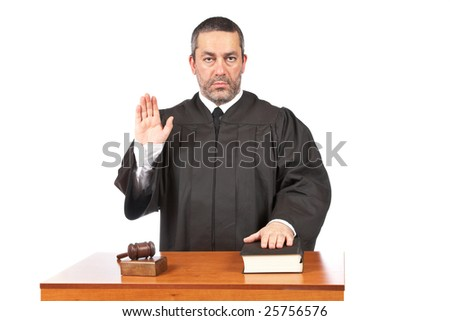 A serious male judge taking oath in a courtroom, isolated on white background. Shallow depth of field - stock photo