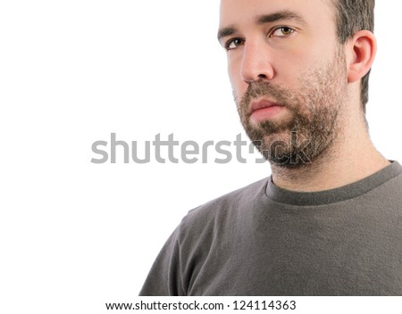 A serious man with a beard, isolated on a white background.