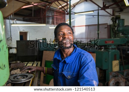 A service repairmen working in workshop during his shift