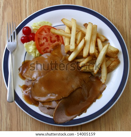A serving of hot roast beef sandwich. - stock photo