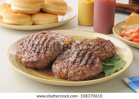 A serving platter of grilled hamburgers