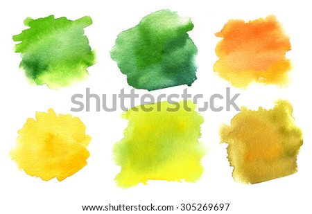 A set of abstract watercolour stains in the green and golden colours of summer and autumn, on white background
