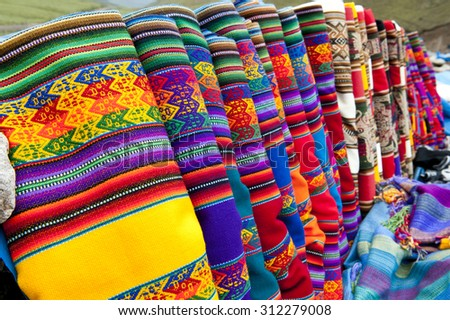 A set of alpaca designed scarves being sold on a cloudy day. - stock photo